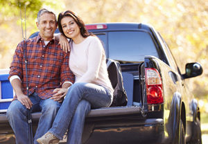 Couple Sitting In Pick Up Truck On Camping Holiday to the Great Smoky Mountains